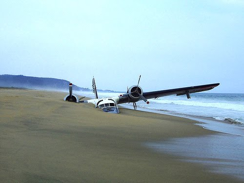 Beached vintage prop airplane